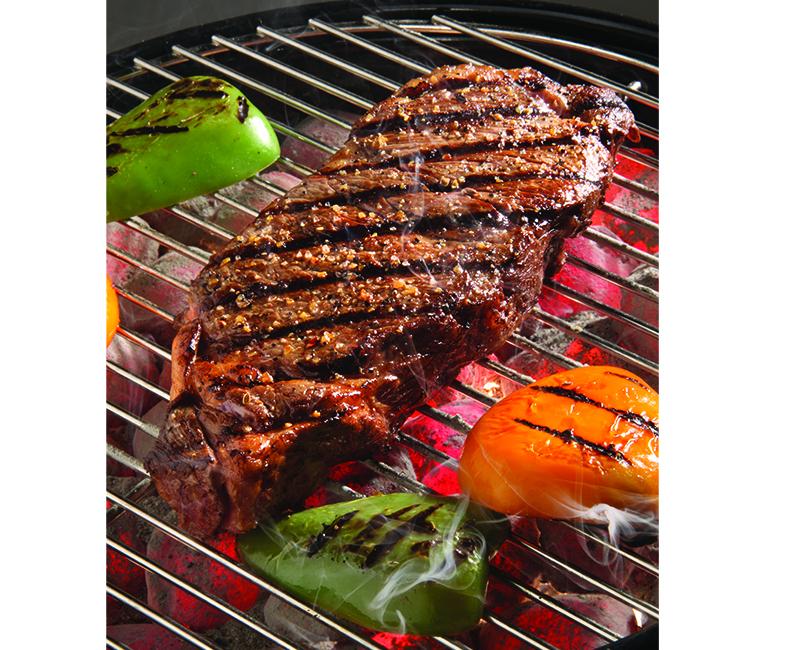 boneless kc strip on grill with smokeHH0314