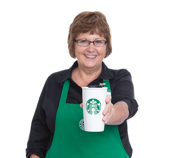 Cathy Bjorgo starbucks manager with cup of coffee