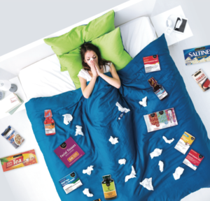 Woman sick in bed with Best Choice cold prevention products: graphic for giveaway